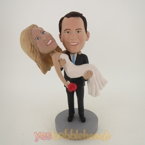 Picture of Custom Bobblehead Doll: Groom Happily Holding Up Bride