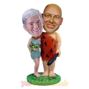 Picture of Custom Bobblehead Doll: Savage Couple Holding Flintstone